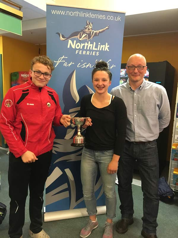 James Linklater from Northlink Ferries presenting Orkney captains Mia McAllister and Hamish Burgon with the West Mainland Chamber of Commerce cup
