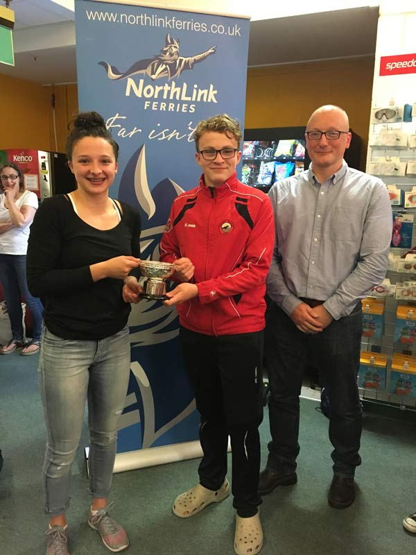 James Linklater from Northlink Ferries presenting Orkney captains Mia McAllister and Hamish Burgon with the Sugarbowl