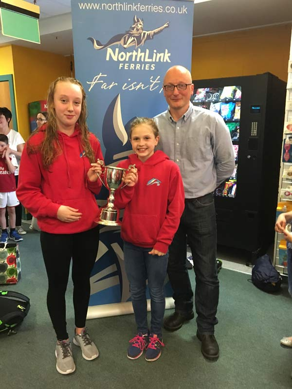 James Linklater from Northlink Ferries presenting Thurso captains Erin McDonald and Alex Mackay with the Northlink Ferries Trophy